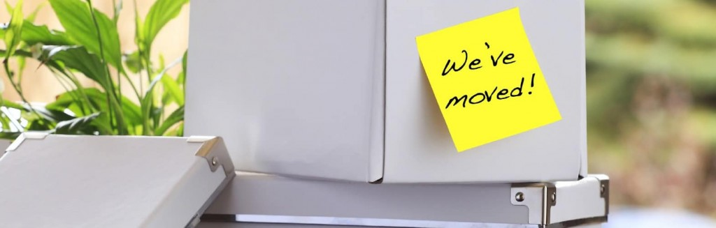 Office box with a sticky note saying we've moved illustrates a Commercial Real Estate Group of Tucson blog article.