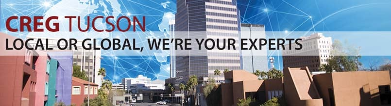 """""""Local to global, we're your experts"""" is a tagline over a photo of downtown Tucson."""