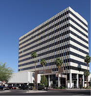 Photo of multi-story Tucson office space building with floors alternately colored white and black.